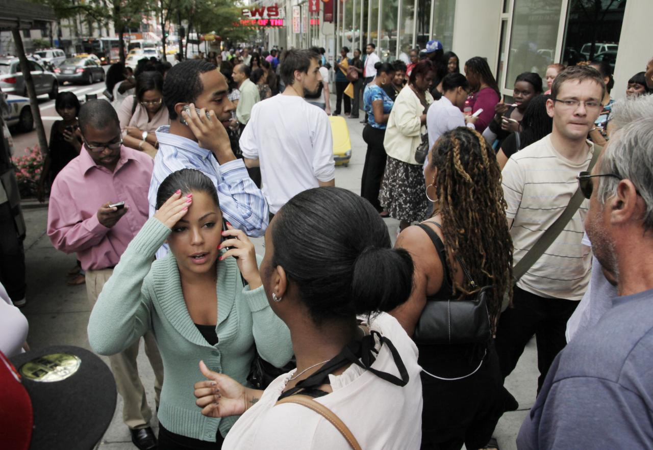 Office workers gather on a sidewalk after their building was evacuated following an earthquake in New York on Tuesday, Aug. 23, 2011. The 5.9 magnitude earthquake centered northwest of Richmond, Va., shook the much of the east coast from Washington, D.C., to New York City and Rhode Island. (AP Photo/Mark Lennihan)