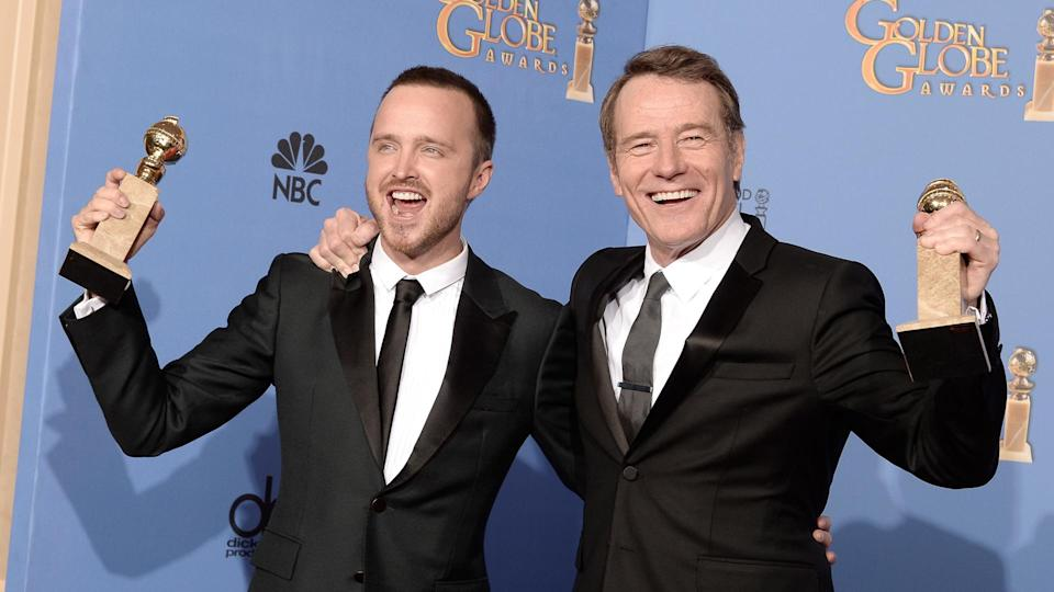 BEVERLY HILLS, CA - JANUARY 12:  Actors Aaron Paul (L) and Bryan Cranston, winners of Best Series - Drama for 'Breaking Bad,' pose in the press room during the 71st Annual Golden Globe Awards held at The Beverly Hilton Hotel on January 12, 2014 in Beverly Hills, California.