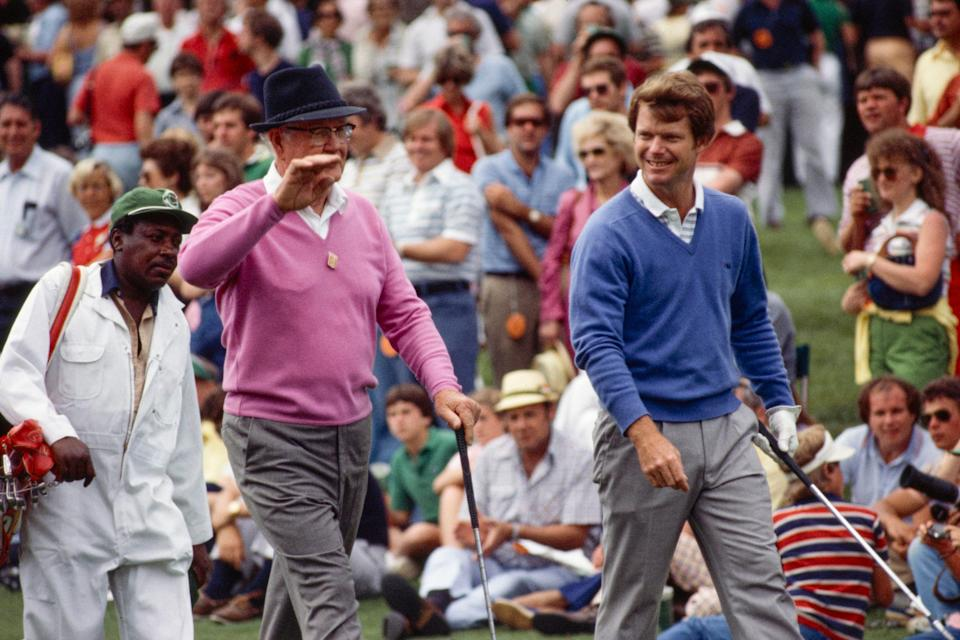 Tom Watson is joined by Byron Nelson during the 1981 Masters Par-3 Contest at Augusta National on April 8, 1981.