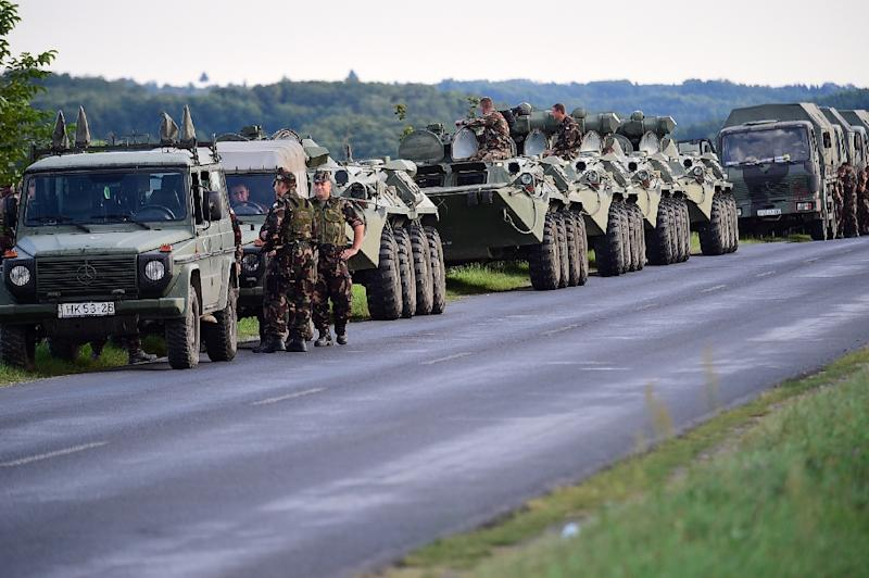 A military convoy is seen on a main road near Nagykanizsa, Hungary, close to the Hungarian-Croatian border, on September 19, 2015 (AFP Photo/Attila Kisbenedek)