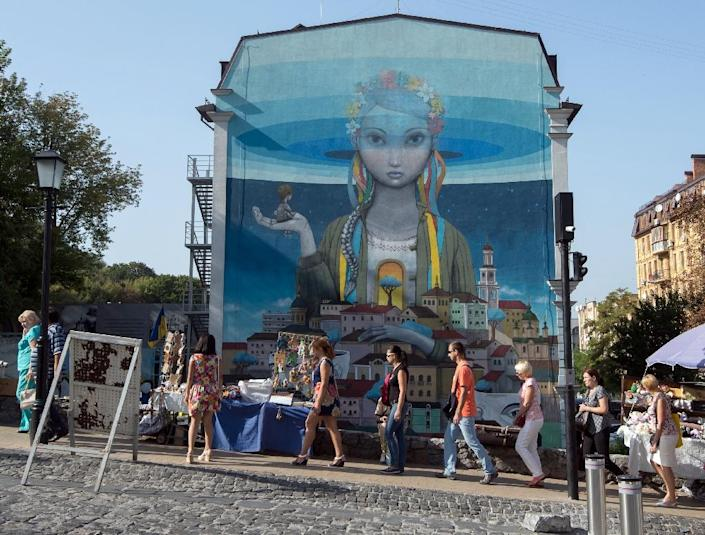 In just a year, Kiev has exploded with dozens of street art projects created by both Ukrainian and international artists (AFP Photo/Genya Savilov)