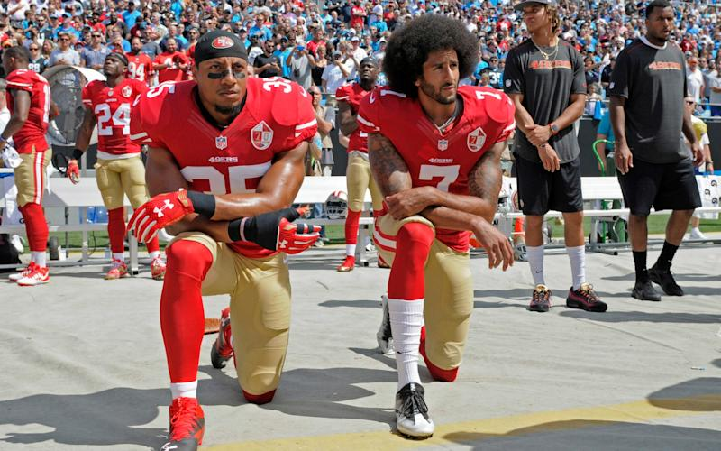 Colin Kaepernick, right, was not supported by the NFL when he protested in 2016 - AP