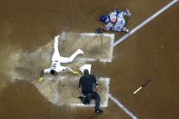 Milwaukee Brewers' Pablo Reyes scores safely past Chicago Cubs catcher Willson Contreras during the eighth inning of a baseball game Saturday, Sept. 18, 2021, in Milwaukee. Reyes scored on a hit by Kolten Wong. (AP Photo/Morry Gash)