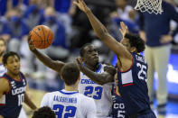 Creighton forward Damien Jefferson (23) makes a layup against Connecticut forward Josh Carlton (25) in the first half during an NCAA college basketball game Saturday, Jan. 23, 2021, in Omaha, Neb. (AP Photo/John Peterson)