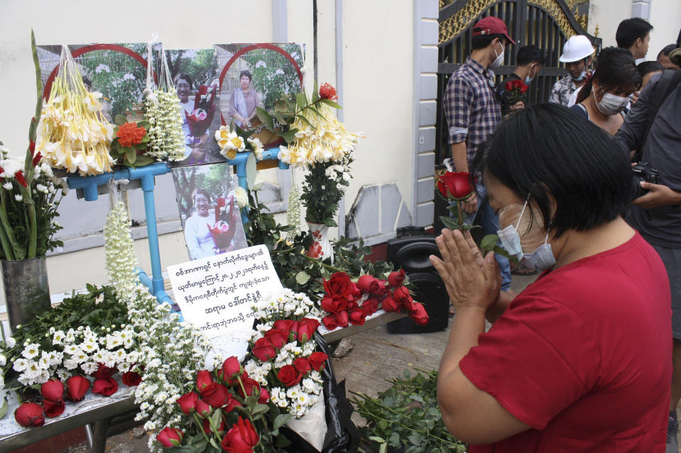 A woman pays tribute to a teacher who died in a protest on Feb 28, during a memorial service in Yangon, Myanmar, Monday, March 1, 2021. (AP Photo)