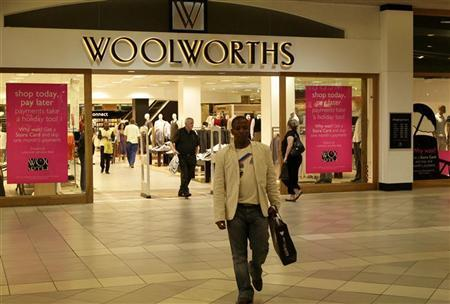 A man leaves a Woolworths shop in Sandton