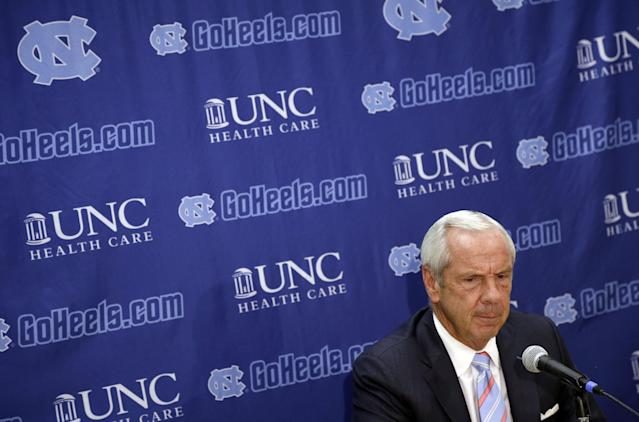 North Carolina coach Roy Williams listens to a question during the team's NCAA college basketball media day in Chapel Hill, N.C., Thursday, Sept. 26, 2013. (AP Photo/Gerry Broome)