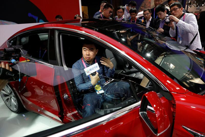 The Tesla Model 3 is displayed during a media preview of the Auto China 2018 motor show in Beijing