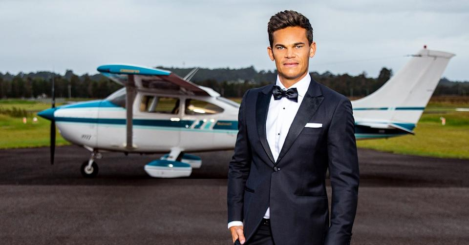 The Bachelor 2021 Jimmy Nicholson in front of a private plane.
