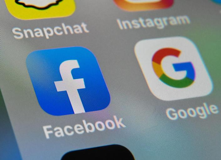 <p>Under a new code, platforms funded by digital advertising could have to be more transparent about how they are using consumers' data</p> (AFP via Getty Images)