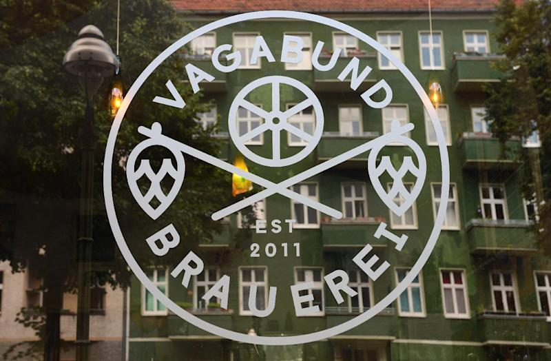 The logo of Berlin's Vagabund Brewery, founded by three US nationals in Berlin in 2011, is seen on the window of the brewery in Berlin's Wedding district on July 11, 2014 (AFP Photo/John MacDougall)