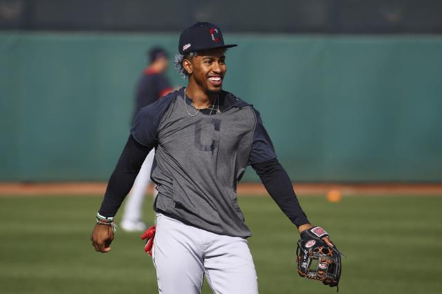 Cleveland Indians shortstop Francisco Lindor smiles as he works on infield drills during spring training baseball workouts Friday, Feb. 21, 2020, in Goodyear, Ariz. (AP Photo/Ross D. Franklin)