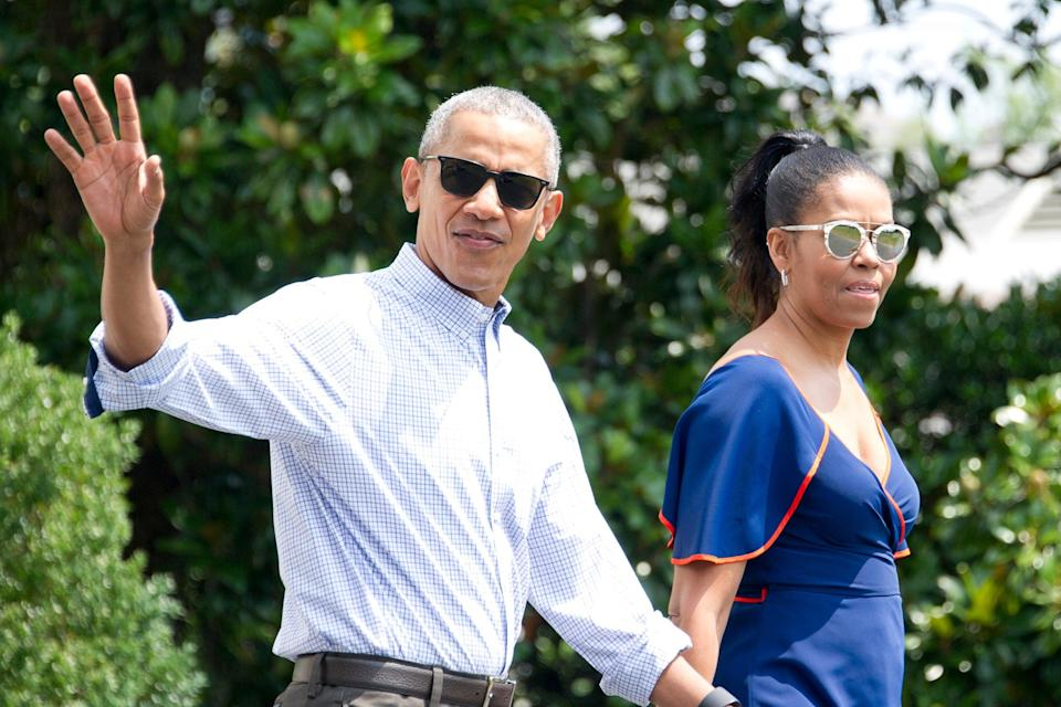 Friends in high places: Barack and Michelle have been embracing the VIP life (Getty Images)