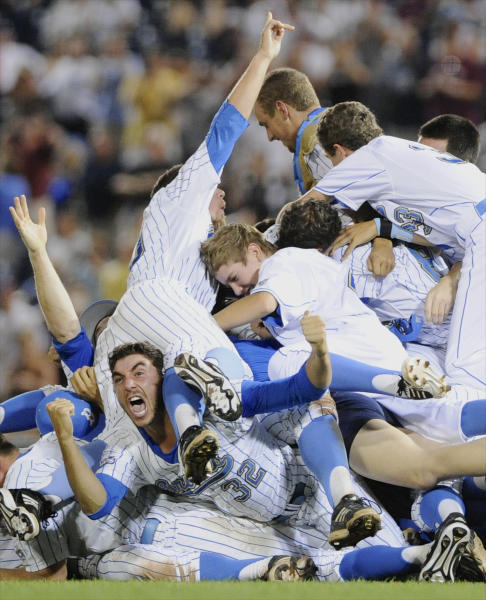 UCLA players pile up after beating Mississippi State 8-0 in Game 2 of the NCAA College World Series baseball finals, Tuesday, June 25, 2013, in Omaha, Neb., winning the championship. (AP Photo/Eric Francis)