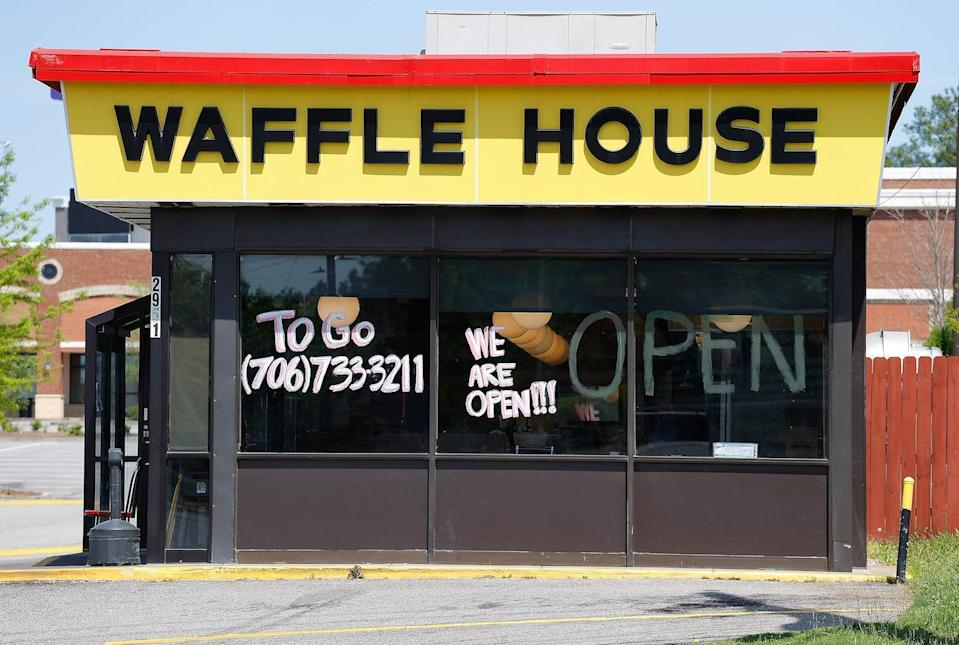 """<p>Notorious for withstanding major devastation, <a href=""""https://www.thedailymeal.com/news/waffle-house-index-coronavirus/032520?referrer=yahoo&category=beauty_food&include_utm=1&utm_medium=referral&utm_source=yahoo&utm_campaign=feed"""" rel=""""nofollow noopener"""" target=""""_blank"""" data-ylk=""""slk:Waffle House"""" class=""""link rapid-noclick-resp"""">Waffle House</a> began closing select locations in March and reopening dining rooms in April. At open locations, according to the Waffle House Social Distancing Checklist, all associates wear face masks and menus must be either disposable, digital or sanitizable. Some chairs and booths are to be designated closed to allow for social distancing. </p>"""