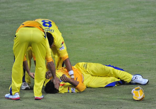 JOHANNESBURG, SOUTH AFRICA - OCTOBER 20: Murali Vijay of CSK lies injured after his catch to dismiss Kieron Pollard of Mumbai during the Karbonn Smart CLT20 match between Chennai Super Kings and Mumbai Indians at Bidvest Wanderers Stadium on October 20, 2012 in Johannesburg, South Africa. (Photo by Duif du Toit / Gallo Images/Getty Images)