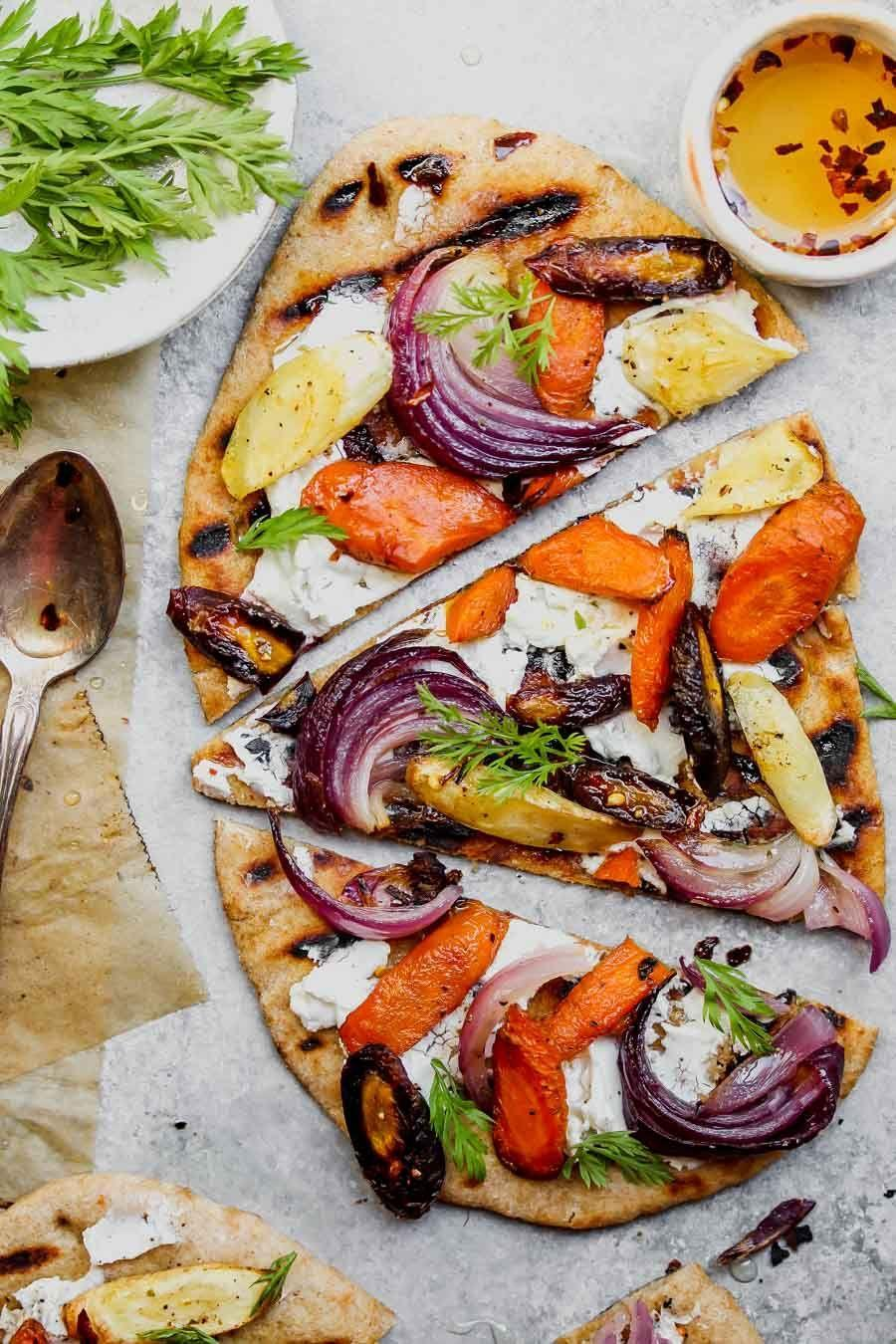 """<p>If you've never tried chili honey on your pizza, the time is now with this healthy take on traditional pizza. The best part about it is that you can customize it to your liking and add as many veggies or fruits to it as you want. </p><p><strong><em>Get the recipe at <a href=""""https://dishingouthealth.com/root-vegetable-and-goat-cheese-mini-pizzas-with-chili-honey/"""" rel=""""nofollow noopener"""" target=""""_blank"""" data-ylk=""""slk:Dishing Out Health."""" class=""""link rapid-noclick-resp"""">Dishing Out Health.</a></em></strong></p>"""