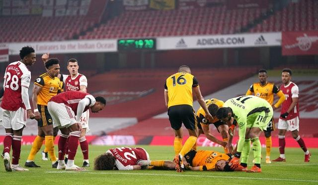 David Luiz of Arsenal and Wolves' Raul Jimenez lie on the ground after a clash of heads