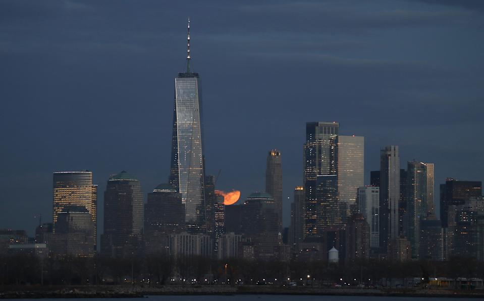 JERSEY CITY, NJ - JANUARY 10: The full Wolf Moon rises behind the skyline of lower Manhattan in New York City on January 10, 2020 as seen from Jersey City, New Jersey. (Photo by Gary Hershorn/Corbis via Getty Images)