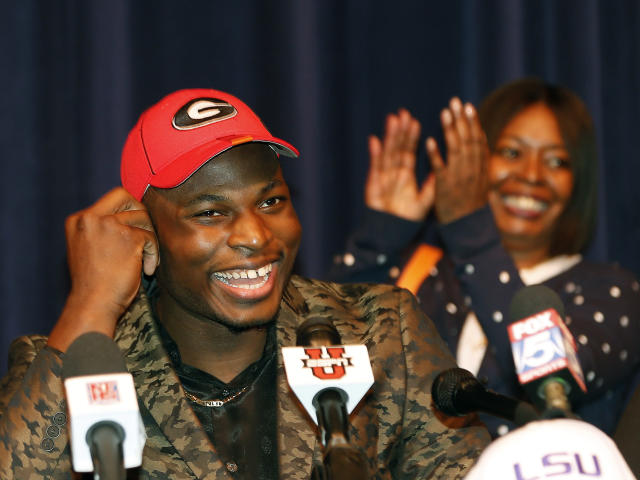 Norcross High School defensive end Lorenzo Carter announces that he plans to play NCAA college football at Georgia during a news conference Wednesday, Feb. 5, 2014, in Atlanta. Carter is regarded as the top prospect in Georgia and one of the top pass-rushers in the nation. (AP Photo/John Bazemore)