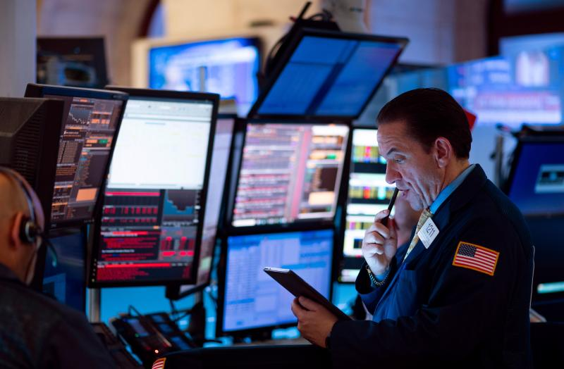 "Traders work before the closing bell at the New York Stock Exchange (NYSE) on August 14, 2019 in New York City. - It was an ugly day for Wall Street, as stocks plummeted Wednesday amid worsening economic fears after US Treasury yields briefly inverted, flashing a warning sign for a coming recession. But US President Donald Trump once again blamed the Fed for the economic woes and the yield curve inversion, saying the US central bank is a bigger threat than China and is ""clueless."" The Dow Jones Industrial Average fell 3.1 percent to finish at 25,479.42, a loss of about 800 points -- its worst day of 2019. (Photo by Johannes EISELE / AFP) (Photo credit should read JOHANNES EISELE/AFP/Getty Images)"