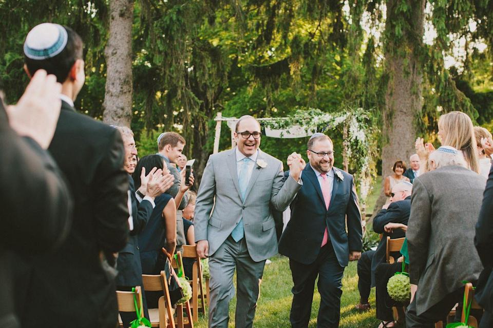 <p>June 6, 2015 was the ideal spring day for on outdoor wedding at deCordova Sculpture Park in Lincoln, MA. Guests explored the grounds before settling into their seats to watch Louis and Lazaro exchange vows under the chuppah. They had initially discussed getting married in Florida (where Laz's family lives) but gay marriage was not legal there yet. The SCOTUS ruling making it legal across all states came through while they were on their honeymoon in Yellowstone.</p>