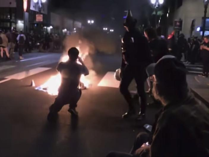 "Protesters set a fire in the street outside of Portland Mayor Ted Wheeler's apartment building on Monday. <p class=""copyright""><a href=""https://www.kgw.com/video/news/local/protests/portland-protests-oregon/283-8dfac259-2aec-45ce-863e-cbbaaaa39774"" rel=""nofollow noopener"" target=""_blank"" data-ylk=""slk:KGW"" class=""link rapid-noclick-resp"">KGW</a></p>"