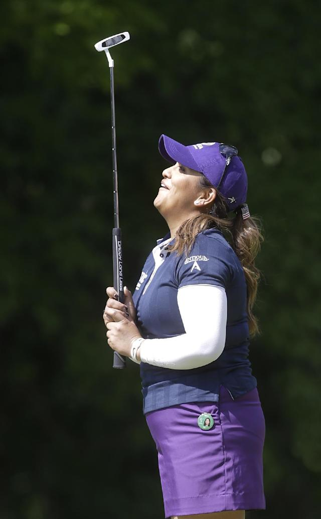 Lizette Salas reacts to a missed birdie putt on the fourth green during the final round of the Kingsmill Championship golf tournament at the Kingsmill resort in Williamsburg, Va., Sunday, May 18, 2014. (AP Photo/Steve Helber)