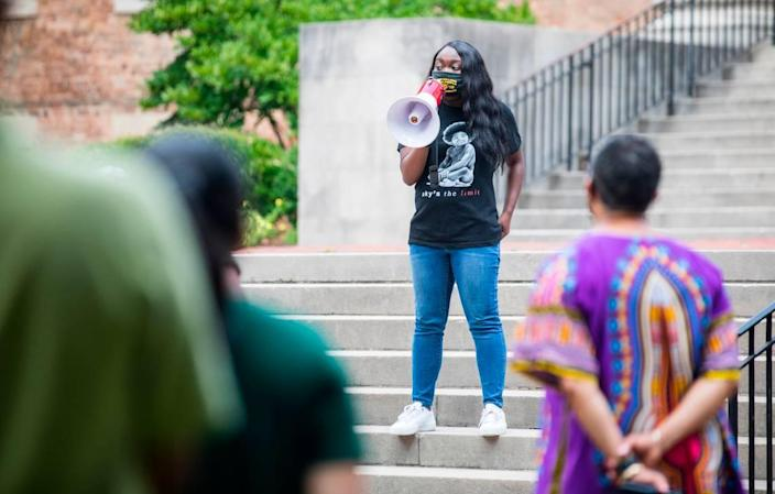 Jarrah Faye, president of the UNC-Chapel Hill chapter of the NAACP, speaks to a small crowd about recent events regarding the tenure of Nikole Hannah-Jones and far-right demonstrations on campus, outside South Building in Chapel Hill, N.C. on Monday, July 12, 2021.