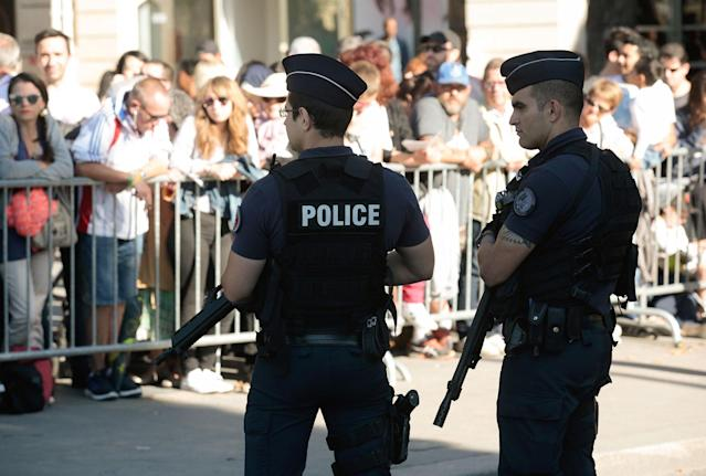 <p>French police stand guard as people wait to watch the annual Bastille Day military parade on the Champs-Elysees avenue in Paris on July 14, 2017. (Photo: Geoffroy Van Der Hasselt/AFP/Getty Images) </p>