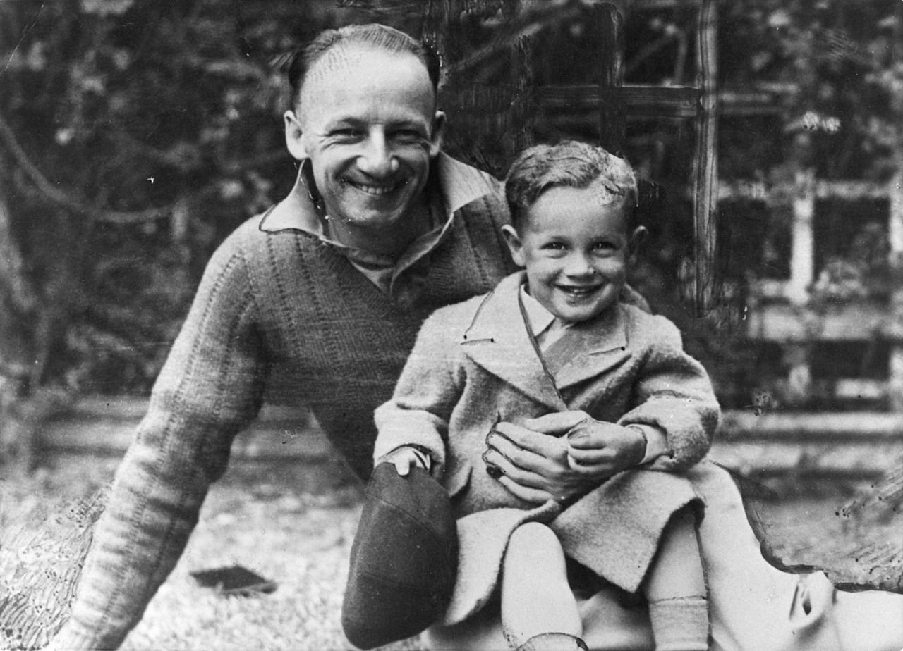 Australian cricketer Don Bradman (1908 - 2001) with his son John Russell. (Photo by Keystone/Getty Images)