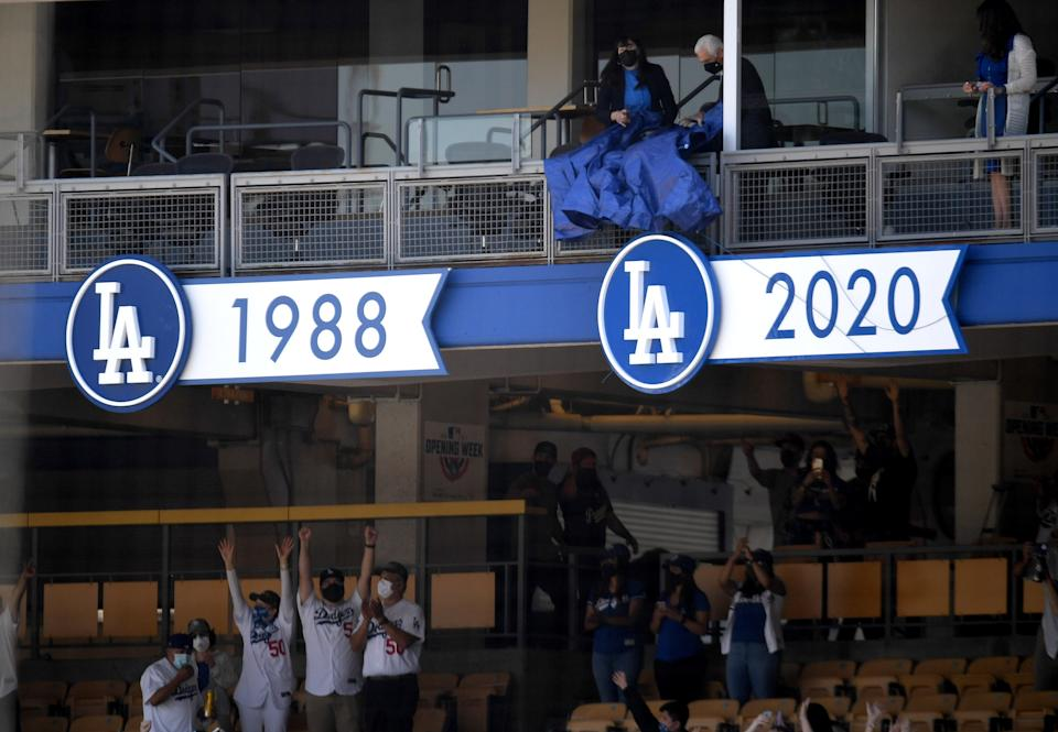 Los Angeles, CA - April 09:  The championship banner is unveiled during the World series ring ceremony prior to a baseball game during Opening Day between the Los Angeles Dodgers and the Washington Nationals in Los Angeles on Friday, April 9, 2021. (Photo by Keith Birmingham/MediaNews Group/Pasadena Star-News via Getty Images)