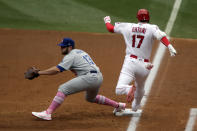Los Angeles Angels designated hitter Shohei Ohtani, right, beats the throw to Los Angeles Dodgers first baseman Max Muncy for an infield single during the first inning of a baseball game in Anaheim, Calif., Sunday, May 9, 2021. (AP Photo/Alex Gallardo)