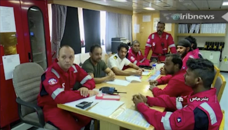 In this photo released by state-run IRIB News Agency, which aired on Monday, July 22, 2019, shows various crew members of the British-flagged tanker Stena Impero, that was seized by Tehran in the Strait of Hormuz on Friday, during a meeting. The Associated Press cannot independently verify the condition of the crew members, but in the video they looked to be in good health and it didn't appear as though they were being filmed under duress. (IRIB News Agency via AP)