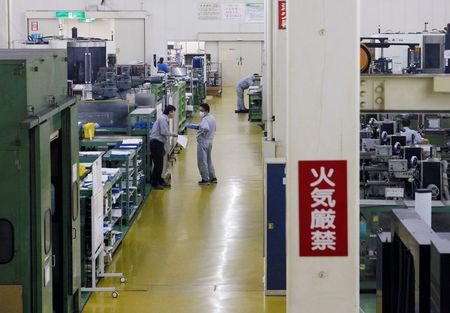 Workers are seen at the factory of Nagumo Seisakusho Co., Ltd. in Jyoetsu
