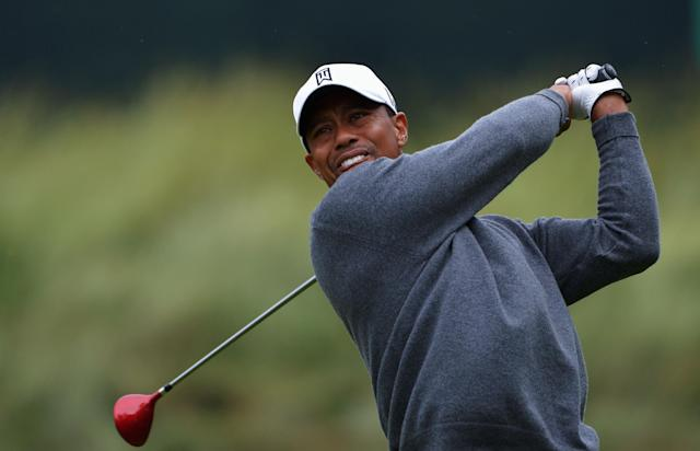 ARDMORE, PA - JUNE 14: Tiger Woods of the United States hits his tee shot on the 18th hole during a continuation of Round One of the 113th U.S. Open at Merion Golf Club on June 14, 2013 in Ardmore, Pennsylvania. (Photo by Drew Hallowell/Getty Images)