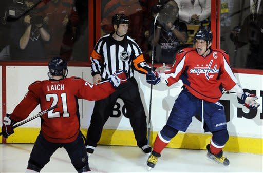 Washington Capitals left wing Alex Ovechkin, right, of Russia, celebrates his goal with Brooks Laich (21) during the second period of Game 3 of an NHL hockey Stanley Cup first-round playoff series against the Boston Bruins, Monday, April 16, 2012, in Washington. (AP Photo/Nick Wass)
