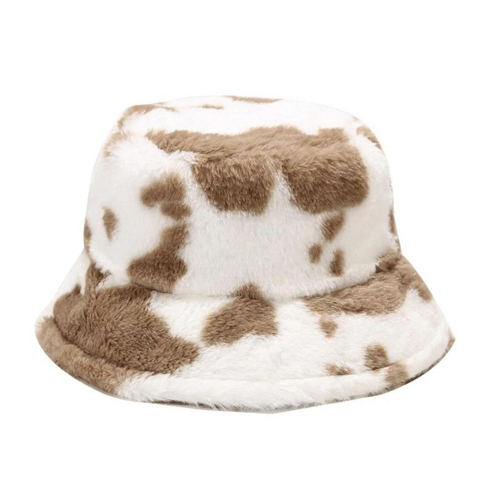 <p>This <span>Fuzzy Cow Print Bucket Hat</span> ($25) packs comfort and style.</p>