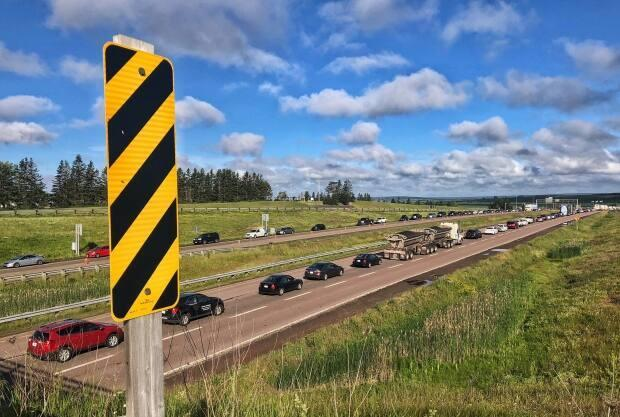 "Vehicles line up at the border between New Brunswick and Nova Scotia during last year's Atlantic bubble. Nova Scotia is ""monitoring"" the COVID-19 situation here but will keep its borders open to New Brunswickers for now, the province's top doctor said Friday."