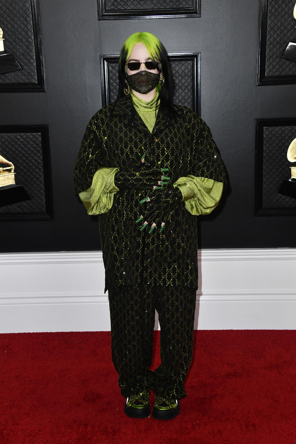 """The 18-year-old showed off her off-beat sense of style in head-to-toe Gucci. The """"Bad Guy"""" singer kept covered up in a glittering face mask, gloves and shades."""