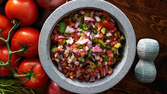 "It's hard to imagine a taco without a chunky, tomato-based sauce, yet too often we don't give much thought to the red (or green) stuff. Making your own salsa can be as simple as chopping tomato, onion and some jalape&ntilde;o -- and making minor tweaks to the formula can yield massive results in the flavor department. Try adding tomatillos (<a href=""http://www.oprah.com/omagazine/Chipotle-Tomatillo-Salsa-and-Avocado-Recipe"" rel=""nofollow noopener"" target=""_blank"" data-ylk=""slk:this recipe uses them exclusively"" class=""link rapid-noclick-resp"">this recipe uses them exclusively</a>) or, as chef Alex Stupak, author of <i><a href=""http://www.amazon.com/Tacos-Recipes-Provocations-Alex-Stupak/dp/0553447297"" rel=""nofollow noopener"" target=""_blank"" data-ylk=""slk:Tacos: Recipes and Provocations"" class=""link rapid-noclick-resp"">Tacos: Recipes and Provocations</a></i>, suggests, use roasted onion, for a subtly sweet flavor."