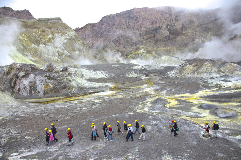 Tourists exploring the inner crater of New Zealand's only active marine volcano White Island.