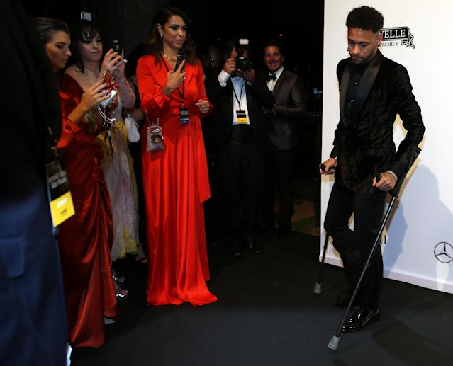 Soccer player Neymar arrives at the eighth annual amfAR Gala Sao Paulo in Sao Paulo, Brazil April 13, 2018. REUTERS/Paulo Whitaker