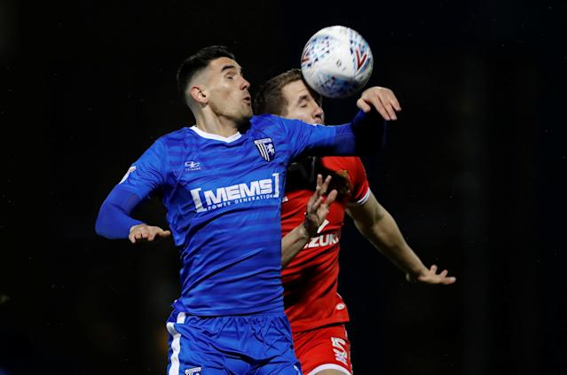 "Soccer Football - League One - Gillingham vs Milton Keynes Dons - MEMS Priestfield Stadium, Gillingham, Britain - March 29, 2018 Gillingham's Conor Wilkinson in action with MK Dons' Scott Wooton Action Images/Peter Cziborra EDITORIAL USE ONLY. No use with unauthorized audio, video, data, fixture lists, club/league logos or ""live"" services. Online in-match use limited to 75 images, no video emulation. No use in betting, games or single club/league/player publications. Please contact your account representative for further details."
