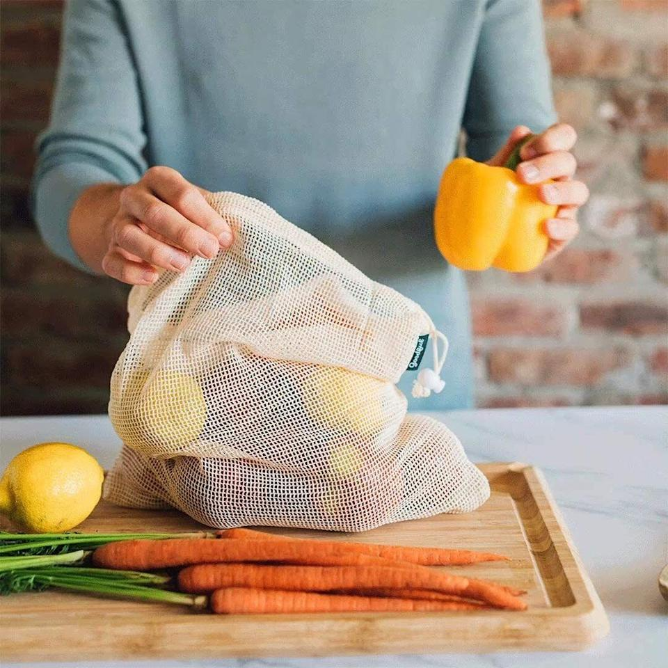 """These are made with a washable 100% cotton material, so you can carry produce in the grocery store, wash it in the sink at home, and keep it organized in the fridge — using the same bag.<br /><br /><strong>Promising review:</strong>""""It seems like such a small thing, bringing your own bags to the store, but over time it saves so much plastic.<strong>In addition to bringing grocery bags, these little bags allow you to bag your own vegetables and fruits.</strong>The bags come in three different sizes (small, medium, and large) and they are color-coded by the size. Red is small, blue is medium and green is large. Due to the soft mesh the bags are made out of, they do not bruise the item and they allow it to breathe. It is easy to close these bags, you just pull tight the drawstring. I had no issues with washing the bags, just throw them into the laundry. I do recommend washing them out in the sink before throwing them into the wash. For drying, just let them hang dry."""" —<a href=""""https://amzn.to/3uUXXjO"""" target=""""_blank"""" rel=""""nofollow noopener noreferrer"""" data-skimlinks-tracking=""""5902331"""" data-vars-affiliate=""""Amazon"""" data-vars-href=""""https://www.amazon.com/gp/customer-reviews/R3HTR9XW64XBCL?tag=bfmal-20&ascsubtag=5902331%2C34%2C37%2Cmobile_web%2C0%2C0%2C16540666"""" data-vars-keywords=""""cleaning"""" data-vars-link-id=""""16540666"""" data-vars-price="""""""" data-vars-product-id=""""20969101"""" data-vars-product-img="""""""" data-vars-product-title="""""""" data-vars-retailers=""""Amazon"""">CNV<br /><br /></a><strong>Get them from BuzzFeed's Goodful collection on Amazon for<a href=""""https://amzn.to/3sn8FO7"""" target=""""_blank"""" rel=""""nofollow noopener noreferrer"""" data-skimlinks-tracking=""""5902331"""" data-vars-affiliate=""""Amazon"""" data-vars-asin=""""B084TMKT1Y"""" data-vars-href=""""https://www.amazon.com/dp/B084TMKT1Y?tag=bfmal-20&ascsubtag=5902331%2C34%2C37%2Cmobile_web%2C0%2C0%2C16540720"""" data-vars-keywords=""""cleaning"""" data-vars-link-id=""""16540720"""" data-vars-price="""""""" data-vars-product-id=""""16659183"""" data-vars-product-img=""""https://m.me"""