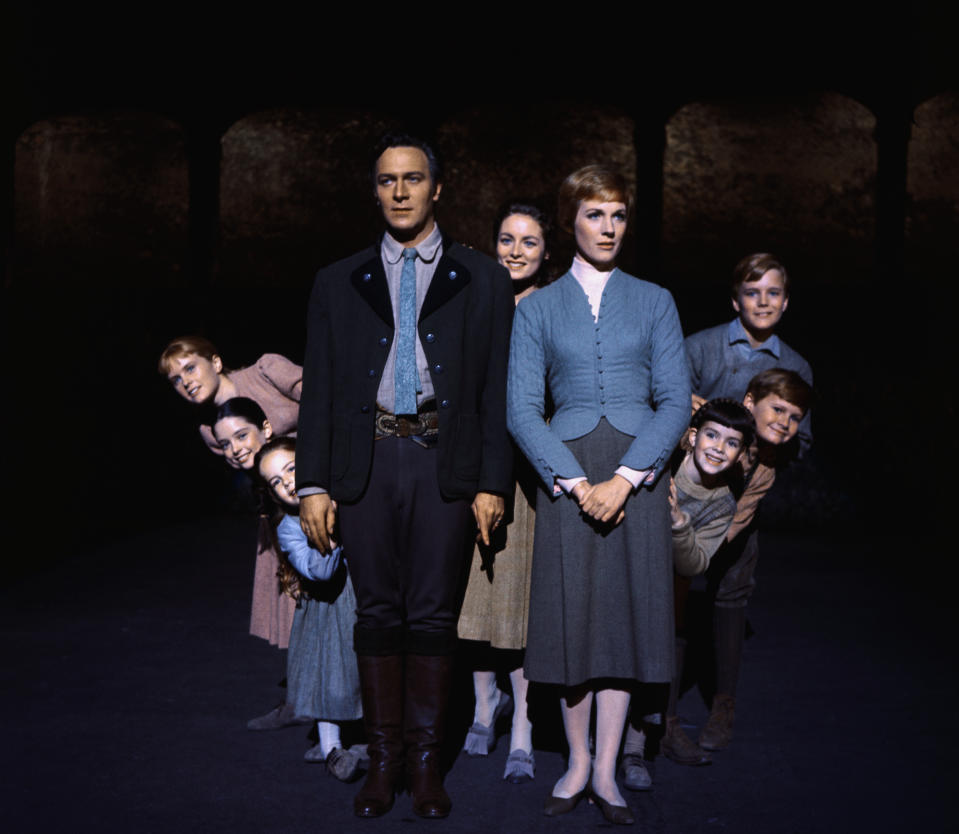 Julie Andrews and Christopher Plummer are flanked on all sides by their children, all members of the singing Von Trapp family, in this publicity handout from the 1965 adaption of the Rogers and Hammerstein musical, The Sound of Music.