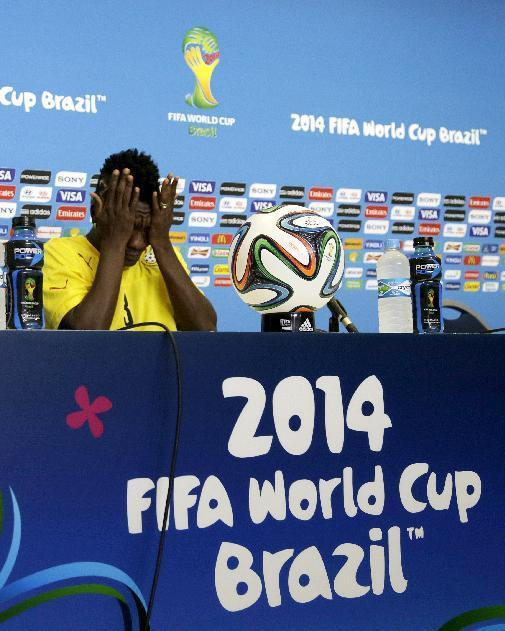 Ghana's Asamoah Gyan prepares himself before a news conference ahead of an official training session the day before the group G World Cup soccer match between Ghana and the United States at the Arena das Dunas in Natal, Brazil, Sunday, June 15, 2014. (AP Photo/Dolores Ochoa)