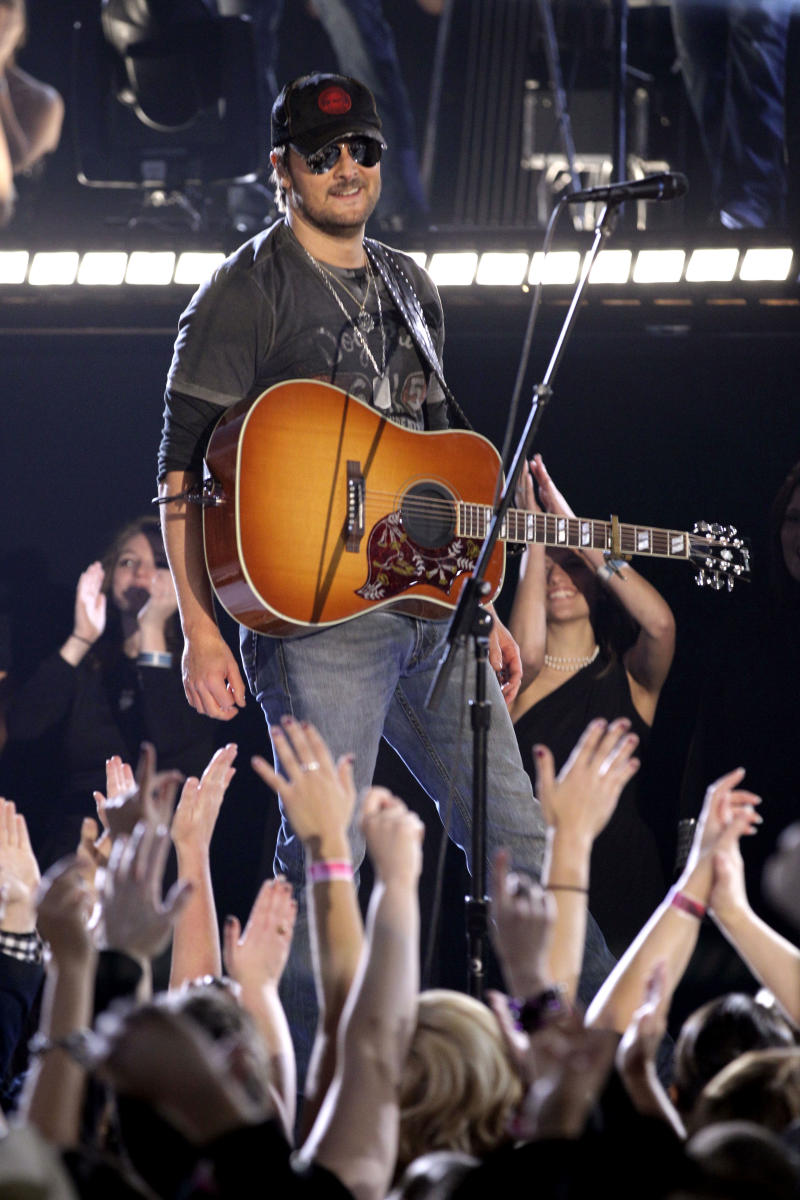 """FILE - In this Nov. 9, 2011 file photo, Eric Church performs """"Drink In My Hand"""" during the 45th Annual CMA Awards in Nashville, Tenn. Church's fans smashed chairs and threw bottles and cans after his planned concert in Buffalo, N.Y., was canceled due to bad weather. The Buffalo News reports said organizers of the WYRK Taste of Country concert decided to halt the multi-act show at around 11 p.m., Friday, June 1, 2012, after strong winds threatened the stage at Buffalo's Coca Cola Field. Church had originally been scheduled to go on at about 9:45 p.m. The singer issued a statement saying he was """"bummed"""" about the cancellation, but planned to return to Buffalo at a later date. (AP Photo/Mark Humphrey, File)"""
