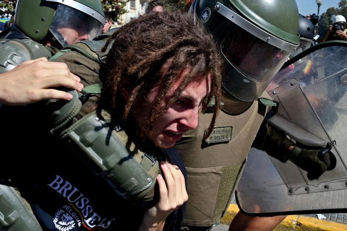 <p>Police detained a student during a protest march demanding education reform in Santiago, Chile, Tuesday, April 11, 2017. The demonstrators are demanding free access to school for all ages including at university level. (AP Photo/Esteban Felix) </p>