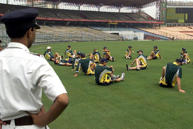 The Australian team warm up under the watchful eye of a local policeman, during training ahead of the 2nd Test against India at Eden Gardens, Calcuuta, India. X DIGITAL IMAGE  Mandatory Credit: Hamish Blair/ALLSPORT